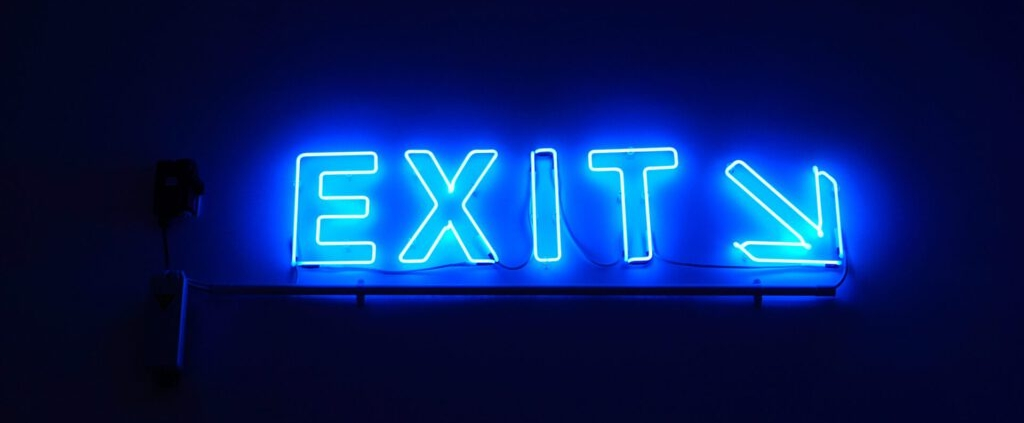 neon sign with text 'exit'